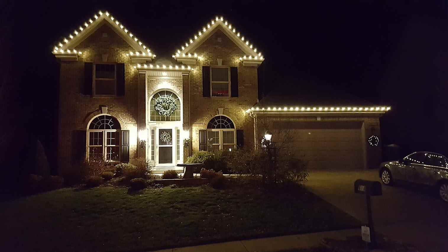 House With Holiday Lights on Peaks