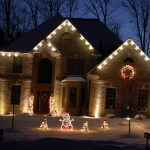 House With Holiday Lights and Lawn Ornaments